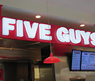 Five Guys at The Florida Mall - LED-illuminated All-Acrylic Channel Letters on Suspended Cabinet