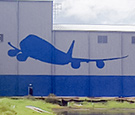 Melbourne International Airport - 88ft long 747 Plane Icon - Routed aluminum composite panels mounted to side of 747 plane hanger