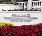 Procacci in Boca Raton, FL - Stainless steel reverse channel letters, radius bars, and flat-cut letters on stand-offs