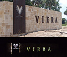 Viera Gateway Sign - Viera, Florida - Halo-lit Corten Steel routed panel and letters over coral veneer