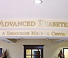 Advanced Diabetes - Flat-cut acrylic lettering with brushed finish metal faces