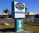 Coral Reef Academy - Pylon Sign with Readerboard and Vandal Cover. Pole cover has a girl on one side, and a boy on the other