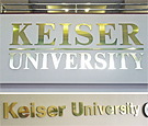 Keiser University Jacksonville, FL - Flat-cut acrylic lettering with brushed finish metal faces