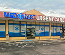 MedFast Urgent Care in Cocoa Beach, FL - Large-format digitally-printed perforated vinyl overlay across storefront