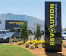 Revolution Technologies - Three-sided monolith sign with internally-illuminated push-thru decoration