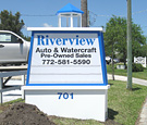 Riverview Auto - V-shaped monument sign with illuminated cupola
