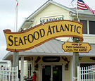Seafood Atlantic - Non-Illuminated Dimensionally Routed Pole Sign and Secondary Panel installed on existing poles