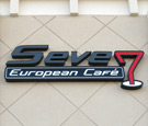 Seven: European Cafe - Channel Letters and Capsule. Letters use perforated vinyl overlay to look black by day, and white by night.